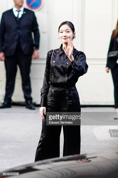Kim Go Eun wears a black outfit outside the Chanel Cruise 2018/2019 Collection at Le Grand Palais on May 03 2018 in Paris France