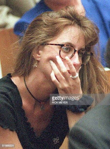 Kim Goldman sister of murder victim Ron Goldman watches as a picture of her brother's bloody shirt is displayed in court during direct examination of...