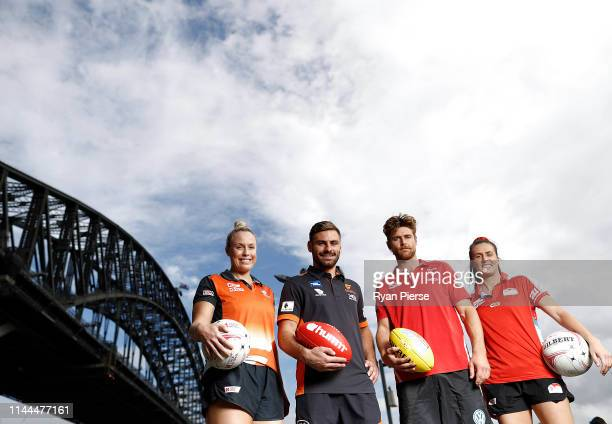Kim Green of the Giants Netball , Stephen Coniglio of the GWS Giants, Dane Rampe of the Sydney Swans, and Maddy Proud of NSW Swifts pose during a...
