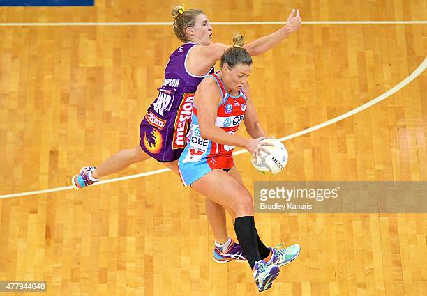 Kim Green of the Swifts and Gabi Simpson of the Firebirds compete for the ball during the 2015 ANZ Championship Grand Final match between the...