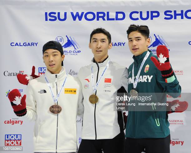 Kim Gun Woo of Korea Wu Dajing of China and Shaoang Liu of Hungary pose with their medals after placing in the 500m men's final during the ISU World...