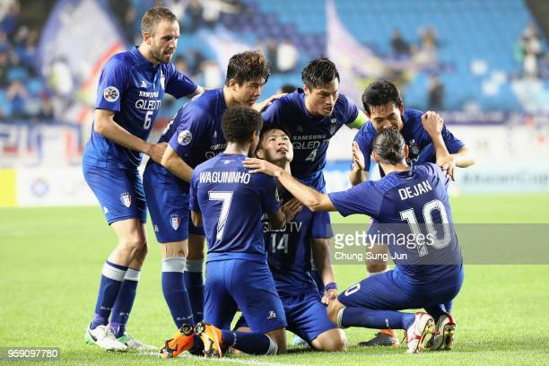 Kim Gunhee of Suwon Samsung Bluewings celebrates scoring his side's second goal with his team mates during the AFC Champions League Round of 16...