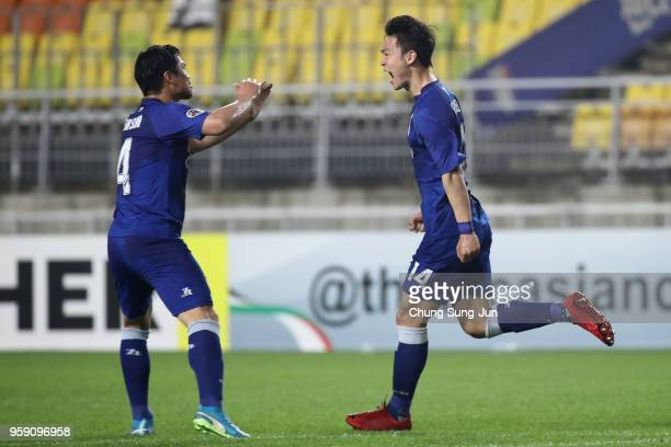 Kim Gun-hee of Suwon Samsung Bluewings celebrates scoring the opening goal with his team mate Kim Eun-sun during the AFC Champions League Round of 16...
