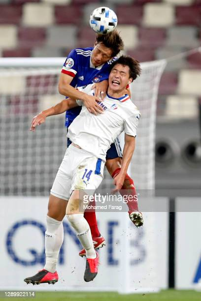 Kim Guniee of Suwon Samsung and Hatanaka of Yokohama F.Marinos compete for the ball during the AFC Champions League Round of 16 match between...