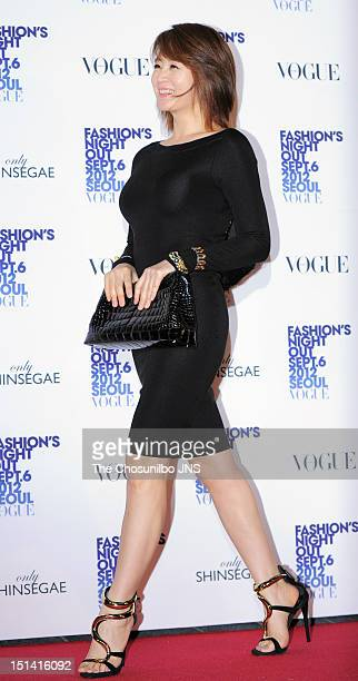 Kim HaeSoo poses for photographs upon arrival during Vogue Fashion's Night Out 2012 Seoul at Shinsegae Department Store on September 6 2012 in Seoul...