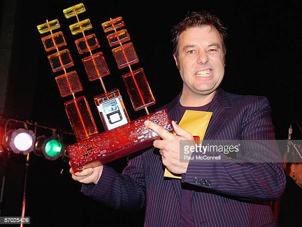 """Kim Hegety manager of the rock band """"The Drones"""" accepts the AMP 2005 at the BigPond Music Winners Event at the Museum Of Contemporary Art on March..."""