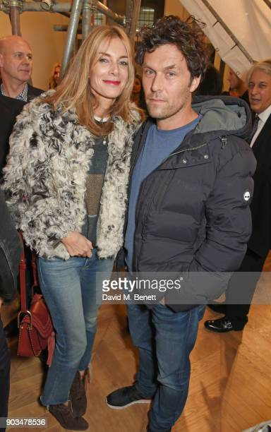 """Kim Hersov and Barry Reigate attend the private view of """"JR: Giants - Body of Work"""" at Lazinc on January 10, 2018 in London, England."""