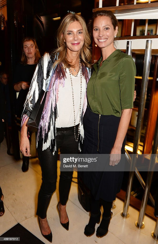 Kim Hersov (L) and Christy Turlington Burns attend a dinner hosted by PORTER in honour of cover girl Christy Turlington Burns and her charity Every Mother Counts at Mr Chow on November 18, 2014 in London, England.