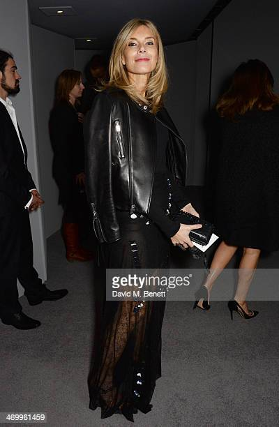 Kim Hersov attends the TOM FORD show at London Fashion Week AW14 at The Lindley Hall on February 17 2014 in London England