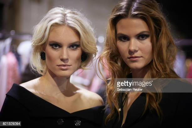 Kim Hnizdo and a model are seen backstage ahead of the Thomas Rath show during Platform Fashion July 2017 at Areal Boehler on July 23 2017 in...