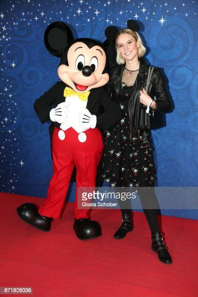 Kim Hnizdo model gntm and Mickey Mouse during the Disney Store VIP opening on November 8 2017 in Munich Germany
