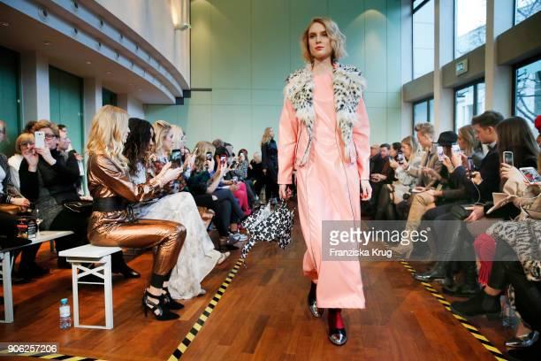 Kim Hnizdo walks the runway during the Rebekka Ruetz Fashion Show at Embassy of Austria on January 16 2018 in Berlin Germany
