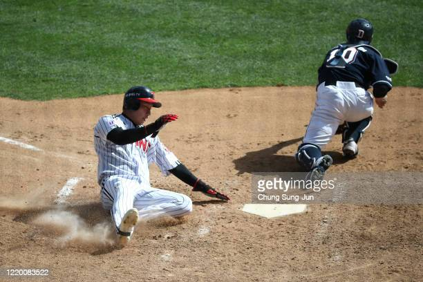 Kim Ho-eun of LG Twins slides safely into the home plate during the preseason game between LG Twins and Doosan Bears at Jamsil Baseball Stadium on...