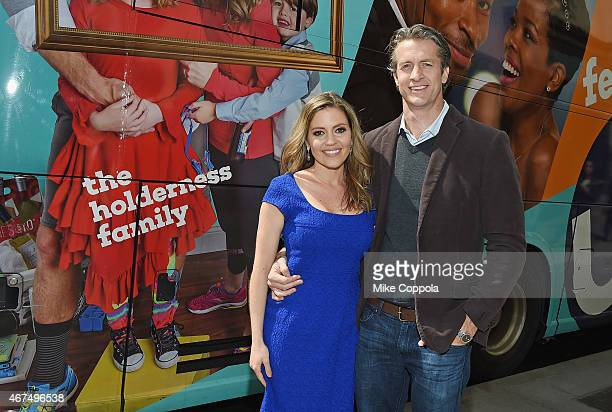 Kim Holderness and husband Penn Holderness pose for a picture at Up Tv's The Holderness Family Photo Call on March 25 2015 in New York City