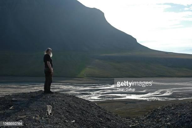 Kim Holmen International Director of the Norwegian Polar Institute stands overlooking the the Bjorndalen valley during a summer heat wave on Svalbard...