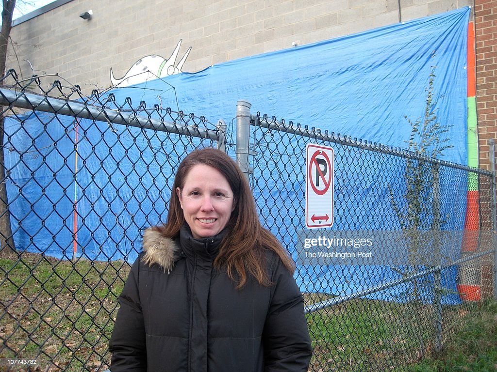 Kim Houghton stands outside Wag More Dogs, her dog boarding