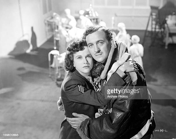 Kim Hunter holding onto David Niven while looking up in a scene from the film 'Stairway To Heaven' 1946