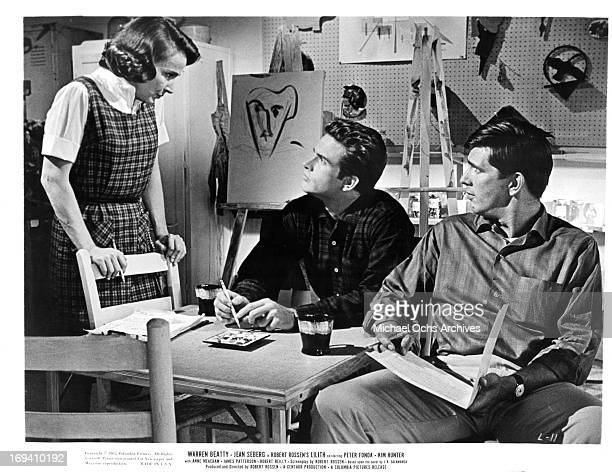 Kim Hunter looking down at Warren Beatty in a scene from the film 'Lilith' 1964