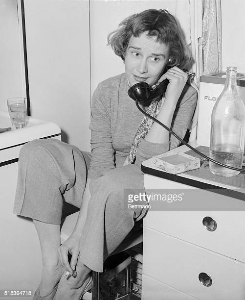 Kim Hunter who was voted Best Supporting Actress for her role in A Streetcar Named Desire hears the news of her Oscar Award on the phone in her...