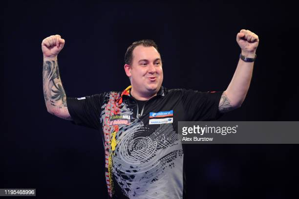 Kim Huybrechts of Belgium celebrates after winning his Third Round match against Danny Noppert of The Netherlands during Day Ten of the 2020 William...