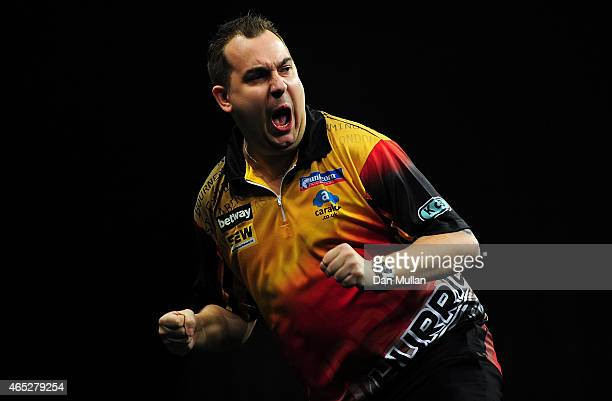 Kim Huybrechts of Belgium celebrates beating Raymond van Barneveld of Holland during The Betway Premier League Darts at Westpoint Arena on March 5...