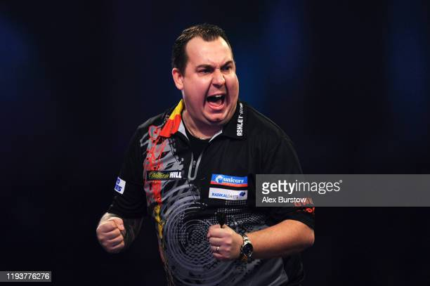 Kim Huybrechts of Belgium celebrates in his First Round match against Geert Nentjes of The Netherlands during Day One of the 2020 William Hill World...