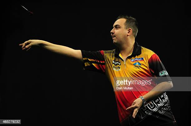 Kim Huybrechts of Belgium in action against Raymond van Barneveld of Holland during The Betway Premier League Darts at Westpoint Arena on March 5...