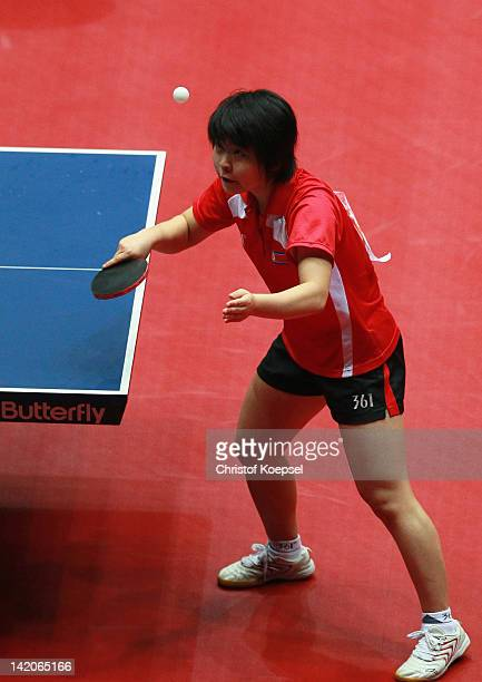 Kim Hye Song of North Korea serves during her match against Wu Jiaduo of Germany during the LIEBHERR table tennis team world cup 2012 championship...