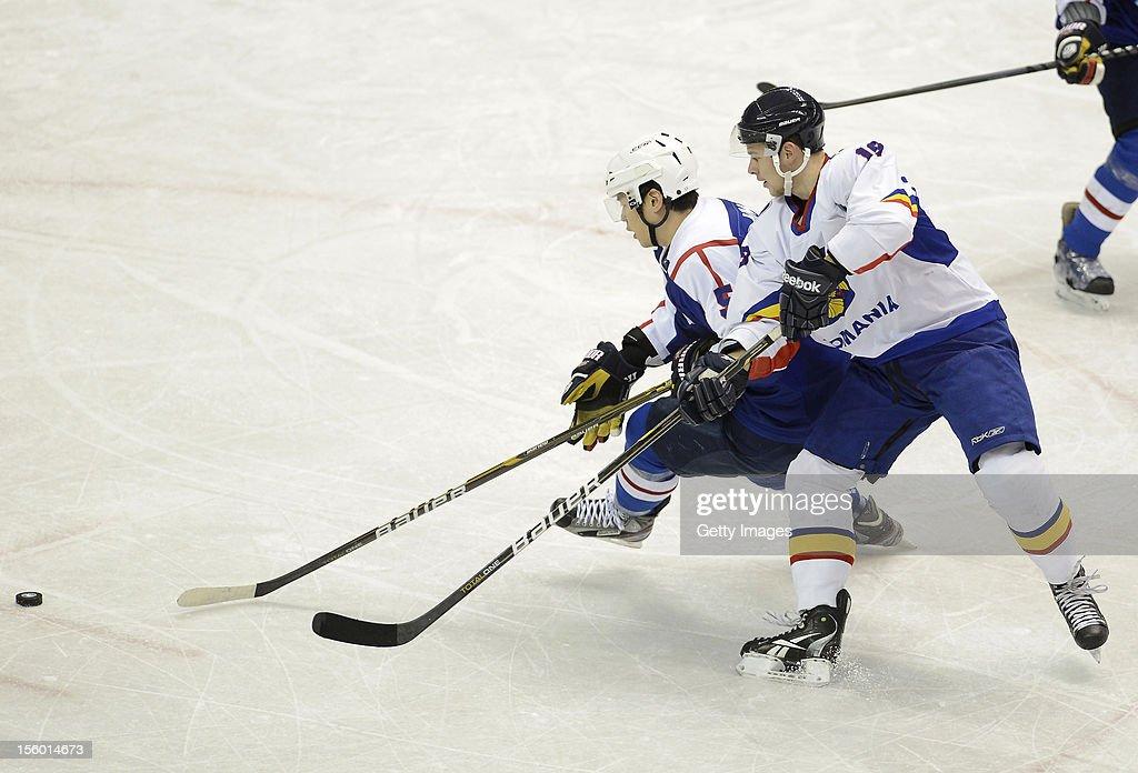 Kim Hyeok #5 of South Korea skates against Tihamer Becze #19 of Romania during the Ice Hockey Sochi Olympic Pre-Qualification Group J match between South Korea and Romania at Nikko Kirifuri Ice Arena on November 11, 2012 in Nikko, Tochigi, Japan. South Korea won 2-0.