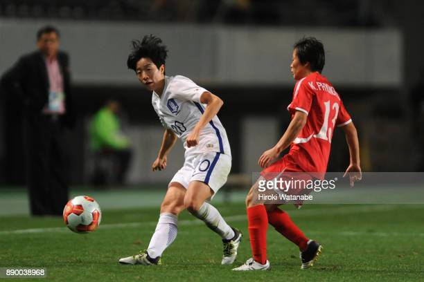 Kim Hyeri of South Korea and Kim Phyong Hwa of North Korea compete for the ball during the EAFF E1 Women's Football Championship between North Korea...