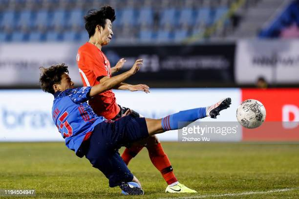 Kim Hyeri of South Korea competes for the ball with Tanaka Mina of Japan during the EAFF E-1 Football Championship match between South Korea and...