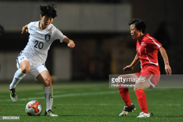 Kim Hyeri of South Korea takes on Kim Phyong Hwa of North Korea during the EAFF E1 Women's Football Championship between North Korea and South Korea...