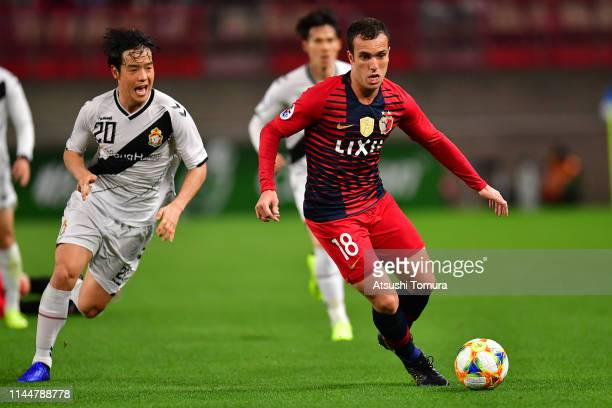 Kim Hyo-Gi of Gyeongnam FC and Serginho of Kashima Antlers in action during the AFC Champions League Group E match between Kashima Antlers and...
