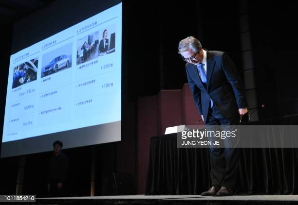 Kim Hyojoon head of the BMW's Korea unit bows during a press conference at a hotel in Seoul on August 6 2018 German automaker BMW apologised on...
