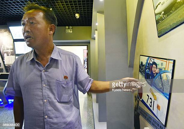 Kim Hyong Chol head of the National House of Class Education in Pyongyang explains articles on display on August 12 2016 North Korea has stepped up...