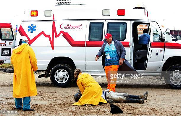 Kim Hyung Chil of Korea is attended to by paramedics after falling from Bundaberg Black during the Equestrian Cross Country event at the 15th Asian...