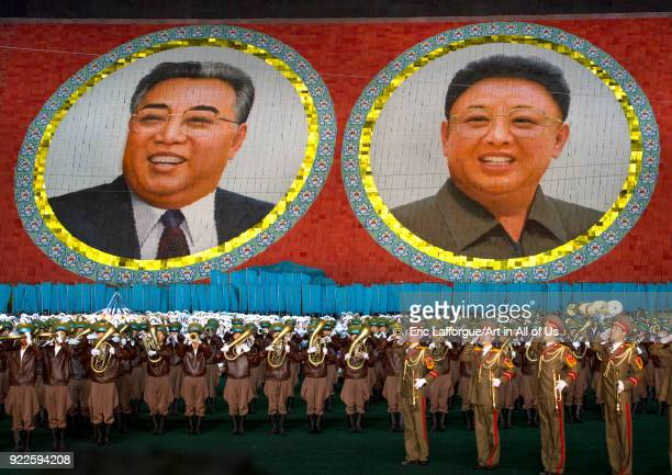Kim il Sung and Kim Jong il portraits made by children pixels holding up colored boards during Arirang mass games in may day stadium Pyongan Province...