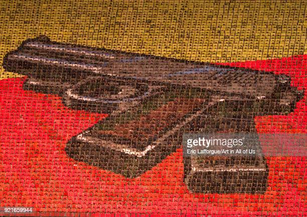 Kim il Sung pistol made by children pixels holding up colored boards during Arirang mass games in may day stadium Pyongan Province Pyongyang North...