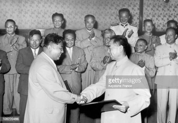 Kim Il Sung The Prime Minister Of The Democratic People'S Republic Of North Korea Shaking Hands With Zhou EnLai The President Of The Chinese Council...