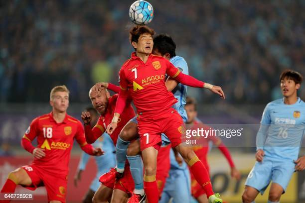 Kim Jaesung of Australia's Adelaide United fights for the ball during the AFC Champions League group stage football match against China's Jiangsu FC...