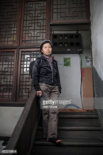 Kim Jeongok a singer and a parttime cleaner and an actress in the upcoming documentary film about Dilkusha House stands on a staircase right outside...