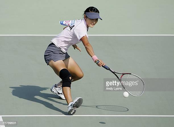 Kim Ji Eun of the Republic of Korea plays a shot in her match against Chiang Wan Chi of Chinese Taipei in the Women's Soft Tennis Singles semi final...