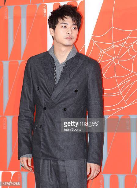 Kim JiHoon poses for photographs during the W Korea campaign Love Your W party at Fradia on October 23 2014 in Seoul South Korea