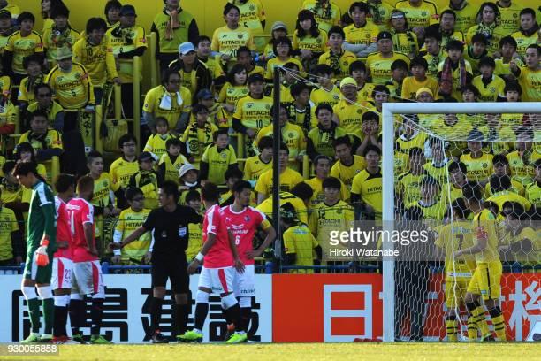 Kim JIn Hyeon of Cerezo Osaka and referee Yudai Yamamoto and Hidekazu Otani of Kashiwa Reysol looks on during the JLeague J1 match between Kashiwa...