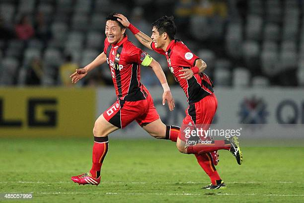 Kim Jin Kyu and Kim Ju Young of FC Seoul celebrate a Mariners own goal during the AFC Asian Champions League match between the Central Coast Mariners...