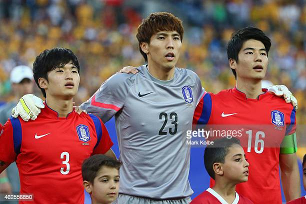 Kim Jin Su Kim Jin Hyeon and Ki Sung Yueng of Korea Republic sing the anthem during the 2015 Asian Cup final match between Korea Republic and the...