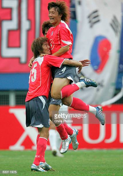 Kim Jin-Kyu of South Korea celebrates with his teammate Kim Jung-Woo during a match between China and South Korea at the East Asian Football...