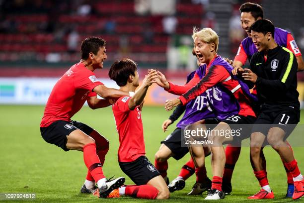 Kim Jinsu of South Korea celebrates scoring with teammates during the AFC Asian Cup round of 16 match between South Korea and Bahrain at Rashid...