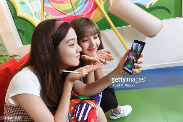 Kim Jisoo and Lalisa Manoban from BLACKPINK having fun trying out Candy Crush Friends Sagas new Hungry Yeti AR feature at the King Offices on August...