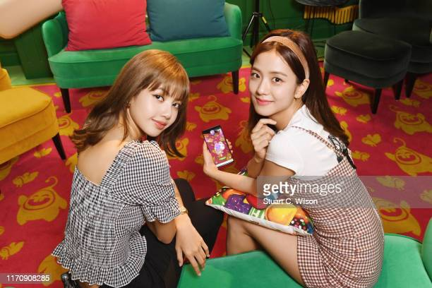 Kim Jisoo and Lalisa Manoban from BLACKPINK try out Candy Crush Friends Sagas new Hungry Yeti AR feature at the King Offices on August 29 2019 in...